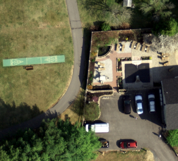 Figure 1. This 3 inch resolution image is useful for identification of small features. The vehicle characteristics, outdoor patio features, and shuffleboard court are easier to identify in this image than on the 6 inch resolution image in Figure 2.