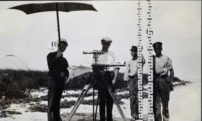 Image showing a 4-man plane table crew with their equipment at Boca Grande, Florida in 1919.