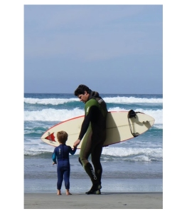 Image of a surfer with a small child.